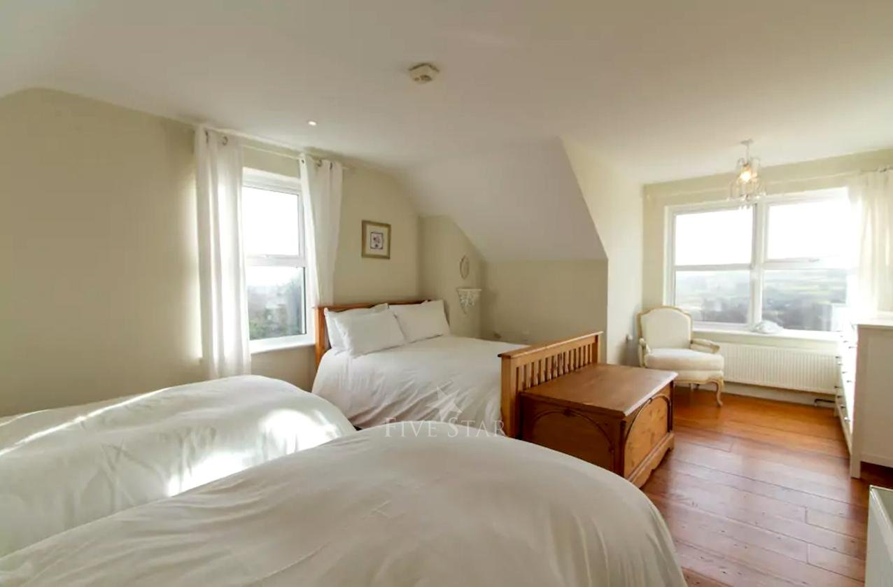 Bedroom 2: 2 single and 1 double bed