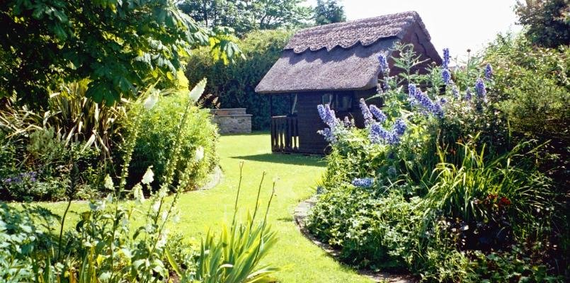 Private, organic gardens with playhouse and swings.