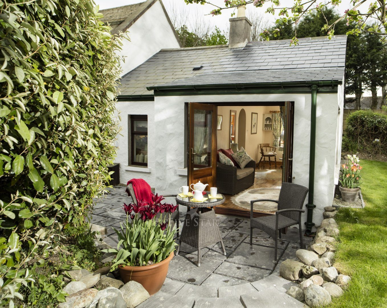 Honeymoon Cottage ~ Garden room with terrace.