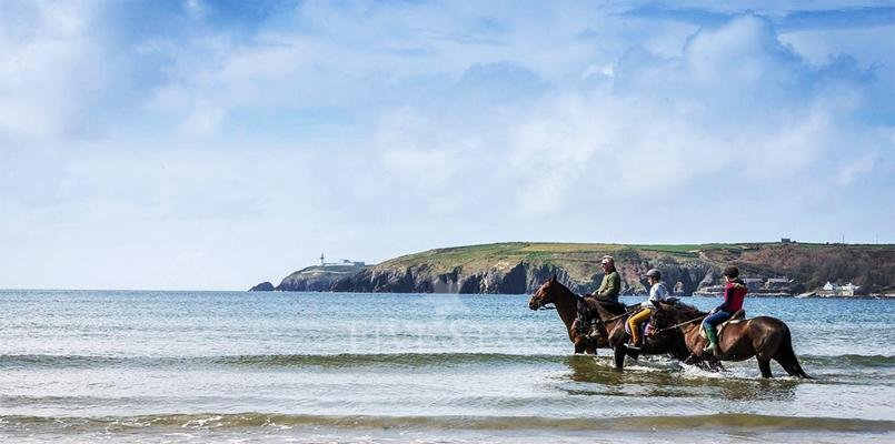 Horse riding on Red Strand