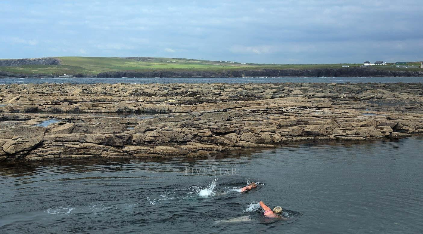 In The Sea At Kilkee photo 7